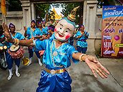18 NOVEMBER 2015 - BANGKOK, THAILAND:  Dancers at Wat Saket during the procession marking the start of the temple's annual fair. Wat Saket is on a man-made hill in the historic section of Bangkok. The temple has golden spire that is 260 feet high which was the highest point in Bangkok for more than 100 years. The temple construction began in the 1800s in the reign of King Rama III and was completed in the reign of King Rama IV. The annual temple fair is held on the 12th lunar month, for nine days around the November full moon. During the fair a red cloth (reminiscent of a monk's robe) is placed around the Golden Mount while the temple grounds hosts Thai traditional theatre, food stalls and traditional shows.     PHOTO BY JACK KURTZ