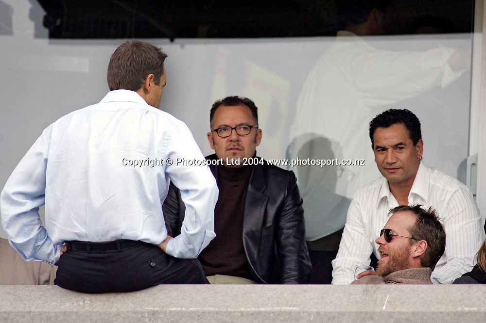 Celebrities Peter Urlich, Temuera Morrison and Keifer Sutherland in the stands during the NRL match between the North Queensland Cowboys and the New Zealand Warriors at Ericsson Stadium, Auckland, New Zealand, on Sunday 20 June, 2004. <br /> The Warriors were defeated 28-26<br /> Copyright photo: www.photosport.co.nz