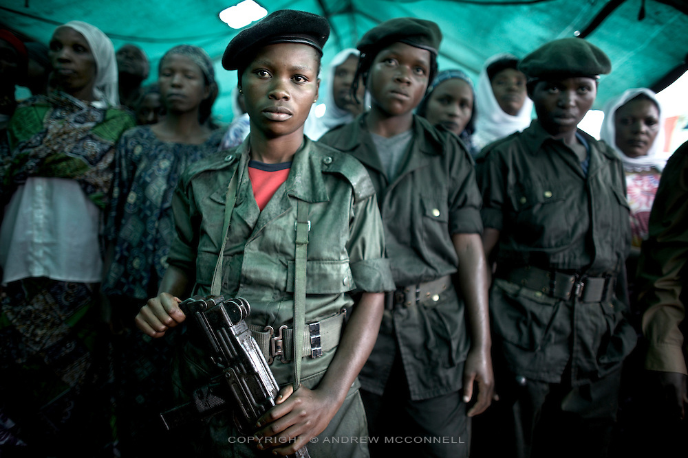 CNDP (National Congress for the Defence of the People) female soldiers loyal to General Nkunda show solidarity with displaced women at a Women's Day event in Kitchanga, DRC.