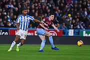 Declan Rice of West Ham United (41) passes the ball under pressure from Steve Mounie of Huddersfield Town (24) during the Premier League match between Huddersfield Town and West Ham United at the John Smiths Stadium, Huddersfield, England on 10 November 2018.