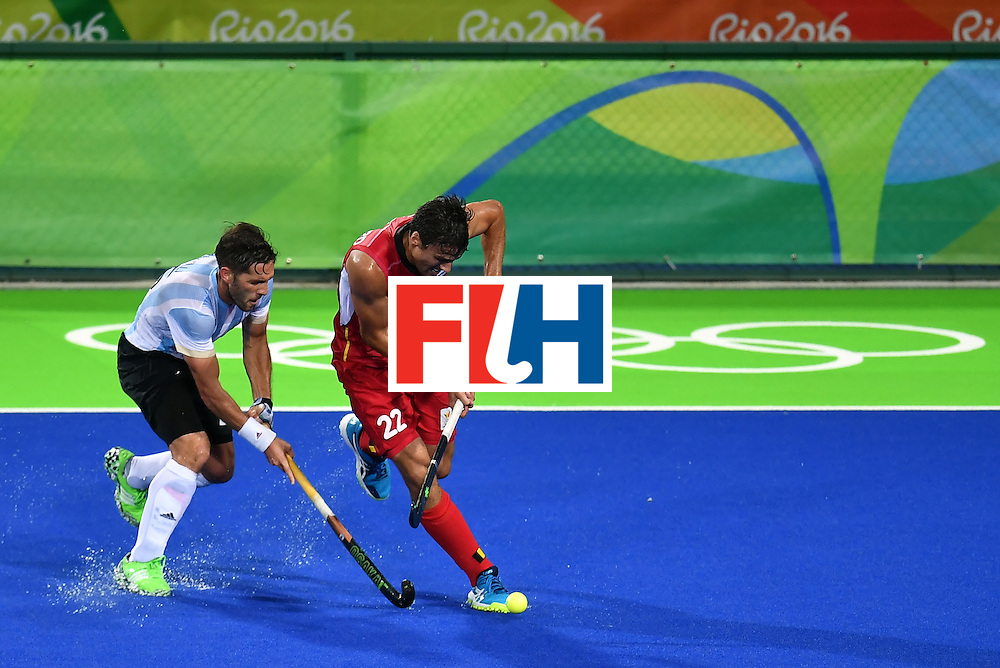 Argentina's Agustin Mazzilli (L) vies with Belgium's Simon Gougnard during the men's Gold medal field hockey Belgium vs Argentina match of the Rio 2016 Olympics Games at the Olympic Hockey Centre in Rio de Janeiro on August 18, 2016. / AFP / MANAN VATSYAYANA        (Photo credit should read MANAN VATSYAYANA/AFP/Getty Images)
