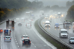© Licensed to London News Pictures. 06/11/2013<br /> Wet weather today (06.11.2013) in Kent.<br /> Drivers on the M25 at Swanley driving in rainy conditions this afternoon.<br /> Photo credit :Grant Falvey/LNP