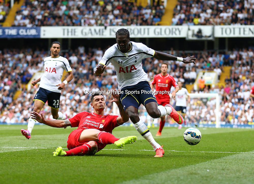 31 August 2014 - Barclays Premier League - Tottenham Hotspur v Liverpool - Dejan Lovren of Liverpool tangles with Emmanuel Adebayor of Tottenham Hotspur - Photo: Marc Atkins / Offside.