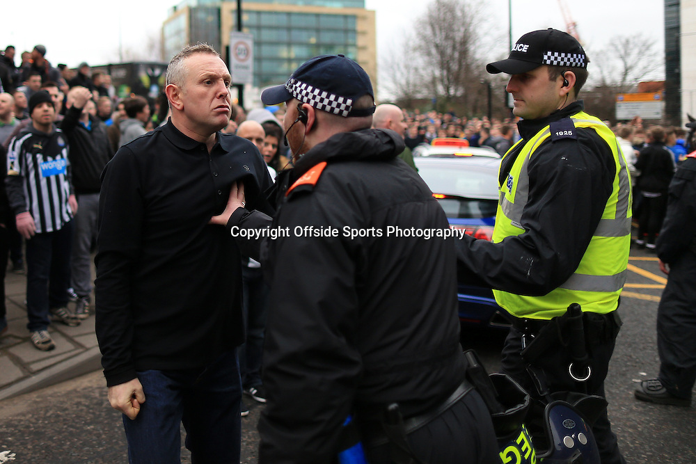 21st December 2014 - Barclays Premier League - Newcastle United v Sunderland - A fan goes head-to-head with a police officer outside the ground - Photo: Simon Stacpoole / Offside.