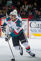 KELOWNA, CANADA - JANUARY 10: Devante Stephens #21 of Kelowna Rockets skates with the puck against the Medicine Hat Tigers on January 10, 2015 at Prospera Place in Kelowna, British Columbia, Canada.  (Photo by Marissa Baecker/Shoot the Breeze)  *** Local Caption *** Devante Stephens;