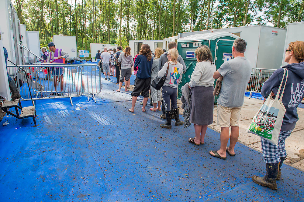 The morning queue for showers in teh Hospitality camping area. The 2015 Glastonbury Festival, Worthy Farm, Glastonbury.
