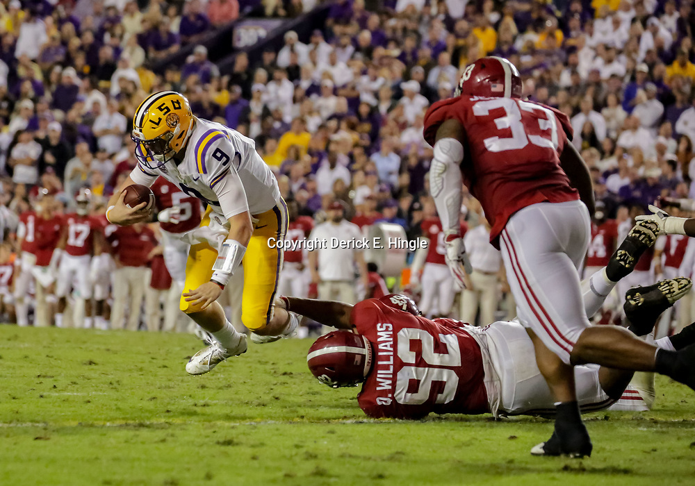 Nov 3, 2018; Baton Rouge, LA, USA; LSU Tigers quarterback Joe Burrow (9) is sacked by Alabama Crimson Tide defensive lineman Quinnen Williams (92) during the third quarter at Tiger Stadium. Mandatory Credit: Derick E. Hingle-USA TODAY Sports