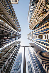 Looking up at row of new skyscrapers in Dubai United Arab Emirates