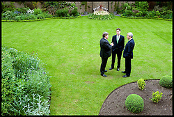 Lord Strathclyde the Leader of the House of Lords (L) talks to the Deputy Prime Minister Nick Clegg(C) and Chris Huhne, the Secretary of State for Energy and Climate Change in the garden of Downing Street, May 13, 2010.  Photo By Andrew Parsons/i-Images