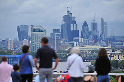 © Licensed to London News Pictures. 30/07/2018<br /> GREENWICH, UK.<br /> View across London.<br /> A cloudy grey day in London, Greenwich Park, Greenwich.<br /> Photo credit: Grant Falvey/LNP
