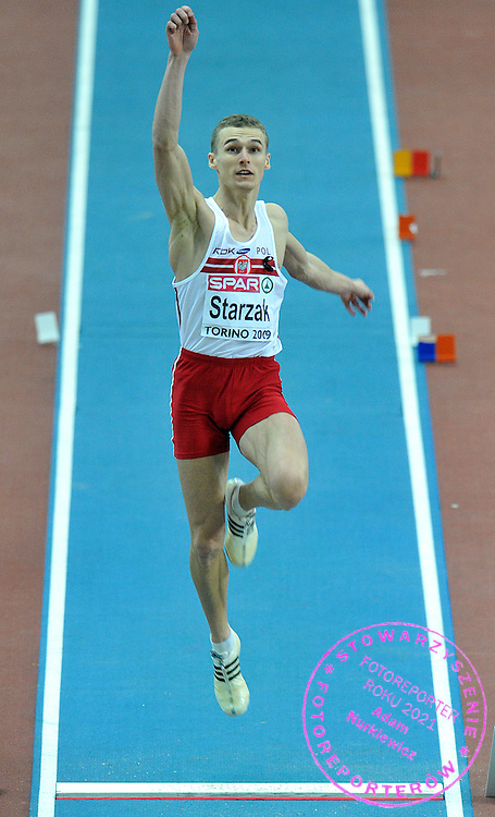 MARCIN STARZAK (POLAND) COMPETES IN LONG JUMP MEN AT OVAL LINGOTTO HALL DURING EUROPEAN ATHLETICS INDOOR CHAMPIONSHIPS TORINO 2009...TORINO , ITALY , MARCH 07, 2009..( PHOTO BY ADAM NURKIEWICZ / MEDIASPORT )