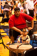 Powwow, father and son, Assiniboine Sioux, American Indian Council Powwow, Montana State University, Montana.