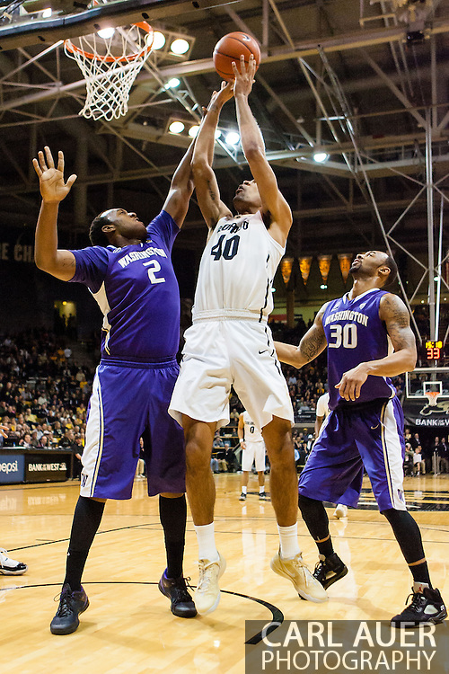February 9th, 2014:  Colorado Buffaloes sophomore forward Josh Scott (40) shoots over Washington Huskies senior forward Perris Blackwell (2) in the first half of the NCAA Basketball game between the Washington Huskies and the University of Colorado Buffaloes at the Coors Events Center in Boulder, Colorado