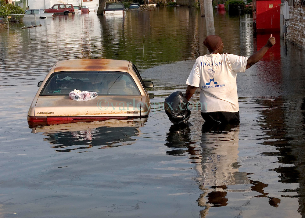 05 Sept  2005. New Orleans, Louisiana. Post hurricane Katrina.<br /> Residents who refuse to leave. A lady wades through the water where some residents of Uptown New Orleans refuse to leave the devastated flood areas.<br /> v