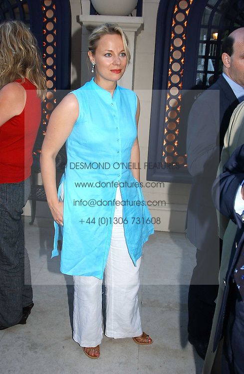 Broadcaster DAISY SAMPSON at a party hosted by Andrew neil and The Business Newspaper held at The Ritz, Piccadilly, London on 12th July 2005.<br />