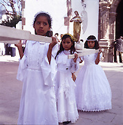 """San Miguel Allende, Mexico: Semana Santa, or Holy Week, celebrates Easter in Mexico and Latin America. The religious holiday takes on a special meaning in the 90% Catholic society, where citizens reenact Passion Plays. The events include processions of penitents, processions where mature women or """"Widows of Christ"""" carry statues through the street, and pre-pubescent """"Brides of Christ"""" also parade through town."""