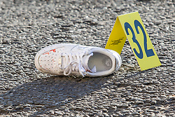 © Licensed to London News Pictures. 01/12/2019. Brighton, UK. Blood can be seen on a shoe at a scenes of crime on Marine Parade in Brighton and Hove after 3 men were hit by a car in the aftermath of a mass fight at 5AM on Sunday Morning. 2 people are in hospital with serious head injuries. The police investigation is continuing. Photo credit: Hugo Michiels/LNP