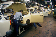 "Six months after the fall of the Berlin Wall, the last Trabant cars come off the factory production line, on 1st June 1990, in Zwickau, eastern Germany (former DDR). The DDR-produced Trabant suffered poor performance, but its smoky two-stroke engine regarded with affection as a symbol of the more positive sides of East Germany. Many East Germans streamed into West Berlin and West Germany in their Trabants after the opening of the Berlin Wall. It was in production without any significant change for nearly 30 years. The name Trabant means ""fellow traveler"" in German."