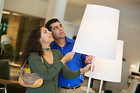 Couple looking at Lamps in furniture store