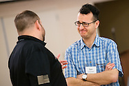 Chaplain candidate the Rev. Sol Grosskopf shares a laugh with Adam Armstrong during a break in the 2015 Operation Barnabas Conference on Monday, Feb. 9, 2015, at Mount Calvary Lutheran Church in San Antonio, Texas.  LCMS Communications/Erik M. Lunsford