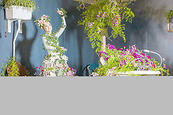April 25, 2018 - Harrogate, Yorkshire, UK - Harrogate UK. Dancer Georgia Paton Durrant wears a flower dress in bathroom of the Green House display at this years Harrogate Flower Show in which starts tomorrow. The GREENhouse has been designed to blur the lines between house and garden, creating a home infused with nature complete with living wallpaper,cascading flower shower, an aromatic bed of herbs and even a vege-table. (Credit Image: © Andrew Mccaren/London News Pictures via ZUMA Wire)