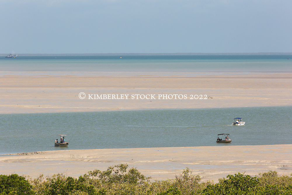 Recreational fishing vessels in Dampier Creek, Roebuck Bay, Broome, Western Australia.