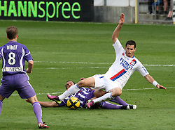 Daniel Braaten tackles Maxime Gonalons. Toulouse v Lyon (2-0), Ligue 1, Stade Municipal, Toulouse, France, 1st May 2011.