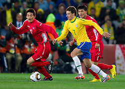 Football - soccer: FIFA World Cup South Africa 2010, Brazil (BRA) - Korea DPR (PRK), Korea's An Yong Hak vs Brazil's Elano during the 2010 FIFA World Cup South Africa Group G match between Brazil and North Korea at Ellis Park Stadium on June 15, 2010 in Johannesburg, South Africa.