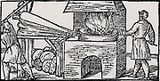 Using bellows to increase the draught in a furnace for refining copper. From 'De la pirotechnia' by Vannoccio Biriguccio (Venice, 1540).