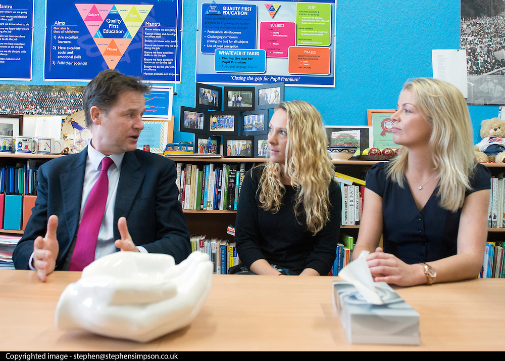 © Licensed to London News Pictures. 22/10/2014. London, UK. Nick Clegg talks with a group of teachers about the bureaucracy they face in school work.  Deputy Prime Minister Nick Clegg visits a school in London on Wednesday 22 October to address an audience of public sector workers - including teachers, social workers, local government and NHS staff, Civil Service apprentices & Fast Streamers. He gave a speech about the public sector as a whole and in it, thanked public sector workers for their hard work through challenging financial times. Photo credit : Stephen Simpson/LNP