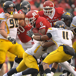 Dec 5, 2009; Piscataway, NJ, USA; Rutgers wide receiver Mohamed Sanu (6) is tackled during second half NCAA Big East college football action in West Virginia's 24-21 victory over Rutgers at Rutgers Stadium.
