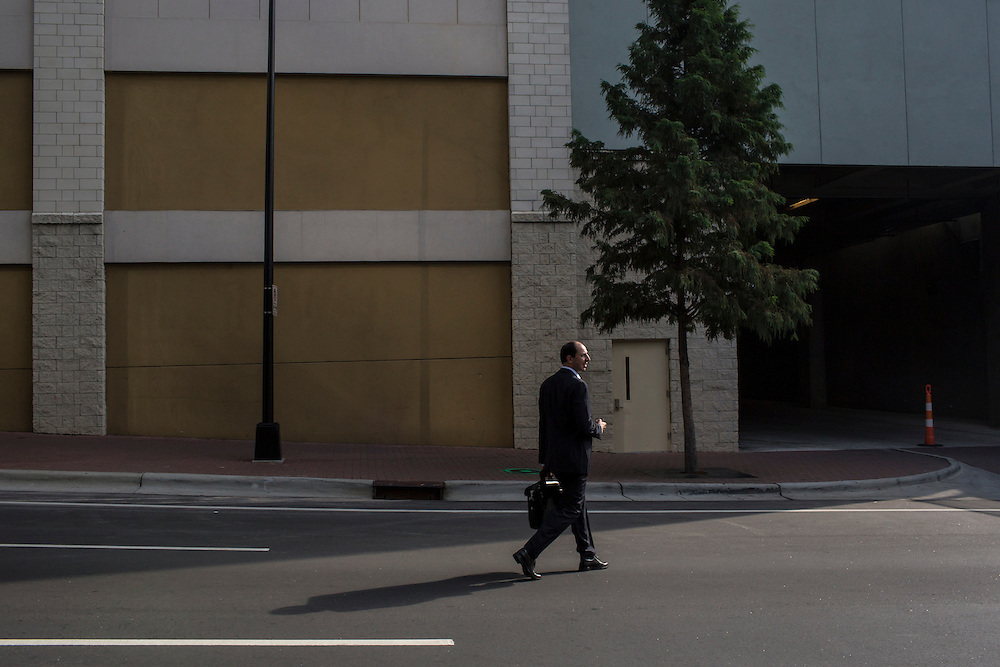 A man walks across the street inside the security perimeter for the Democratic National Convention on Monday, September 3, 2012 in Charlotte, NC.