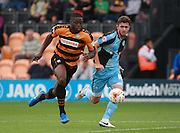 Barnet player John Akinde and Wycombe Wanderers player Dan Rowe race for the ball during the Sky Bet League 2 match between Barnet and Wycombe Wanderers at The Hive Stadium, London, England on 15 August 2015. Photo by Bennett Dean.