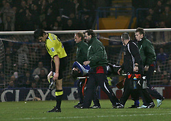 Portsmouth, England - Saturday, February 10, 2007: Portsmouth's Pedro Mendes is carried off after a tackle by Manchester City's Joey Barton (left) who checks his studs are OK after the tackle during the Premiership match at Fratton Park. (Pic by Chris Ratcliffe/Propaganda)