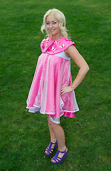LIVERPOOL, ENGLAND, Thursday, April 7, 2011: Racegoer Sarah Wheatcroft from Aintree wearing a pink dress during Liverpool Day on Day One of the Aintree Grand National Festival at Aintree Racecourse. (Photo by David Rawcliffe/Propaganda)