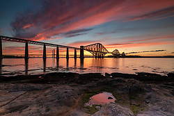 A spectacular sunset over the Forth Bridges in South Queensferry near Edinburgh