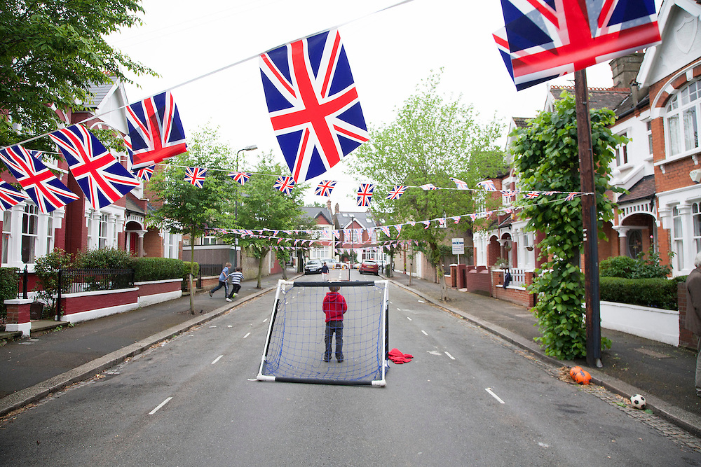 Children playing football to celebrate the Diamond Jubilee at Stroud Road. London 2nd June 2012