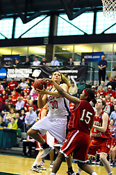 20 March 2010: Jaimie McFarlin reaches in with an attempt to block a shot by Carrie Snikkers. The Flying Dutch of Hope College fall to the Bears of Washington University 65-59 in the Championship Game of the Division 3 Women's NCAA Basketball Championship the at the Shirk Center at Illinois Wesleyan in Bloomington Illinois.