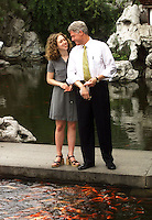 SHA12D:CHINA-CLINTON:SHANGHAI,CHINA,30JUN98 - U.S. President Bill Clinton and daughter Chelsea enjoy the moment as they feed the carp in the Yuyuan Garden during a tour of Shanghai June 30.  The president continues his nine-day state visit to China.   ptb/Photo by Rick Wilking   REUTERS
