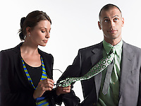 Businesswoman Cleaning Glasses on Tie of Businessman