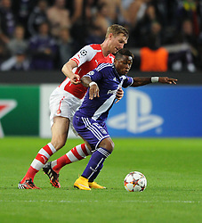 Arsenal's Per Mertesacker holds up Anderlecht's Gohi Bi Cyriac - Photo mandatory by-line: Dougie Allward/JMP - Mobile: 07966 386802 - 22/10/2014 - SPORT - Football - Anderlecht - Constant Vanden Stockstadion - R.S.C. Anderlecht v Arsenal - UEFA Champions League - Group D