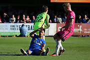 Southend United goalkeeper Ted Smith (22) saving from AFC Wimbledon striker Lyle Taylor (33) during the EFL Sky Bet League 1 match between AFC Wimbledon and Southend United at the Cherry Red Records Stadium, Kingston, England on 25 March 2017. Photo by Matthew Redman.