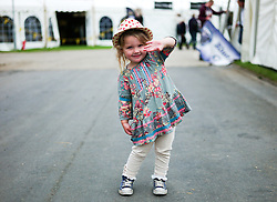 © Licensed to London News Pictures.14/07/15<br /> Harrogate, UK. <br /> <br /> MARTHA CHAPMAN, 2, from Northallerton reacts to the camera as she visits on the opening day of the Great Yorkshire Show.  <br /> <br /> England's premier agricultural show opened it's gates today for the start of three days of showcasing the best in British farming and the countryside.<br /> <br /> The event, which attracts over 130,000 visitors each year displays the cream of the country's livestock and offers numerous displays and events giving the chance for visitors to see many different countryside activities.<br /> <br /> Photo credit : Ian Forsyth/LNP