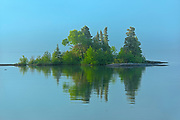 Caron Island reflection on Lake Superior<br />
