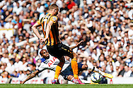 Danny Rose of Tottenham Hotspur beats David Meyler of Hull City to the ball during the Barclays Premier League match at White Hart Lane, London<br /> Picture by David Horn/Focus Images Ltd +44 7545 970036<br /> 16/05/2015