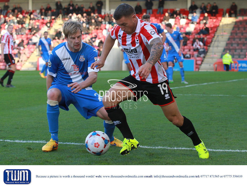 Dan Harding and Lee Vaughan during the Vanarama National League match between Cheltenham Town and Eastleigh at Whaddon Road, Cheltenham, England on 17 October 2015. Photo by Antony Thompson.