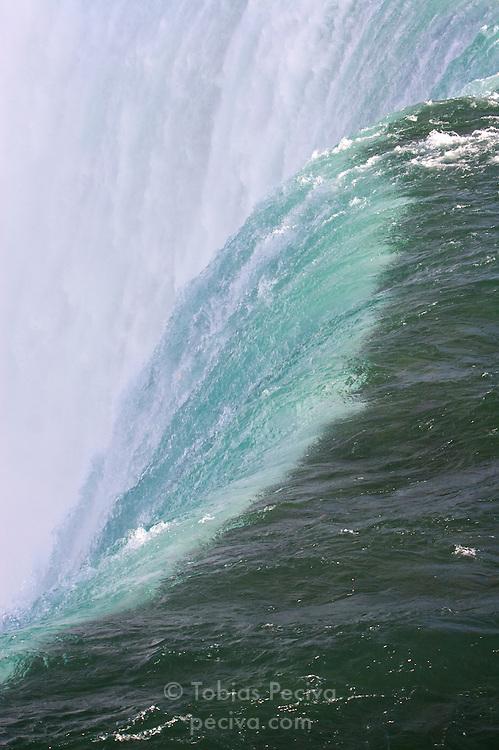 Water flows over the edge of Niagara Falls.
