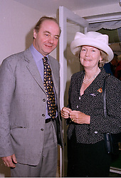 SIR THOMAS & LADY PILKINGTON at a race meeting in Berkshire on 26th July 1997.MAP 35C