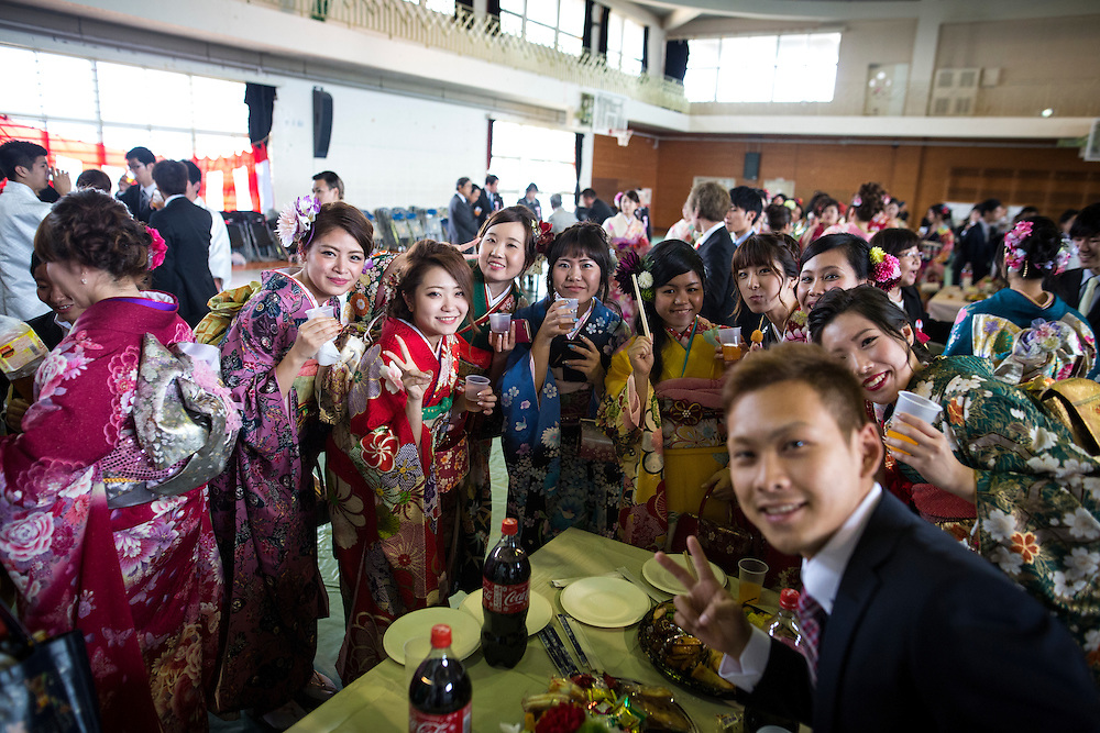 OKINAWA, JAPAN - JANUARY 8 : New adults in kimonos poses for photos after attending a Coming of Age Day celebration ceremony in Shuri Junior High School in Okinawa, Japan on January 8, 2017. The Coming of Age Day, one of the Japanese national holidays, is the day to celebrate young people who have reached the age of 20, the age of maturity in Japan, when they are legally permitted to smoke, drink alcohol and vote. (Photo by Richard Atrero de Guzman/NURPhoto)