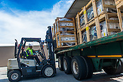 Unloading cargo from a truck with a forklift